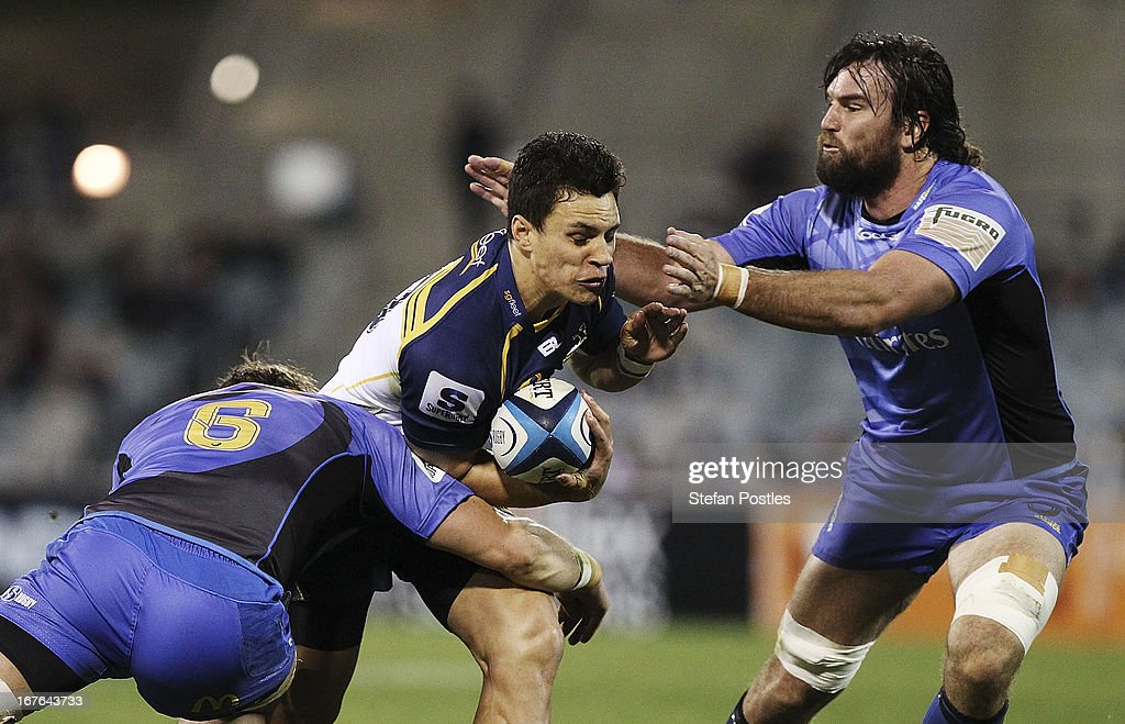 Matt Toomua of the Brumbies is tackled during the round 11 Super Rugby match between the Brumbies and the Force at Canberra Stadium on April 27, 2013 in Canberra, Australia.