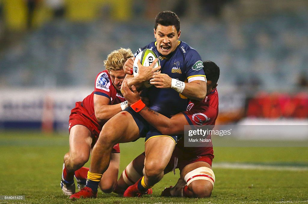 <a gi-track='captionPersonalityLinkClicked' href=/galleries/search?phrase=Matt+Toomua&family=editorial&specificpeople=4695215 ng-click='$event.stopPropagation()'>Matt Toomua</a> of the Brumbies is tackled during the round 15 Super Rugby match between the Brumbies and the Reds at GIO Stadium on July 1, 2016 in Canberra, Australia.