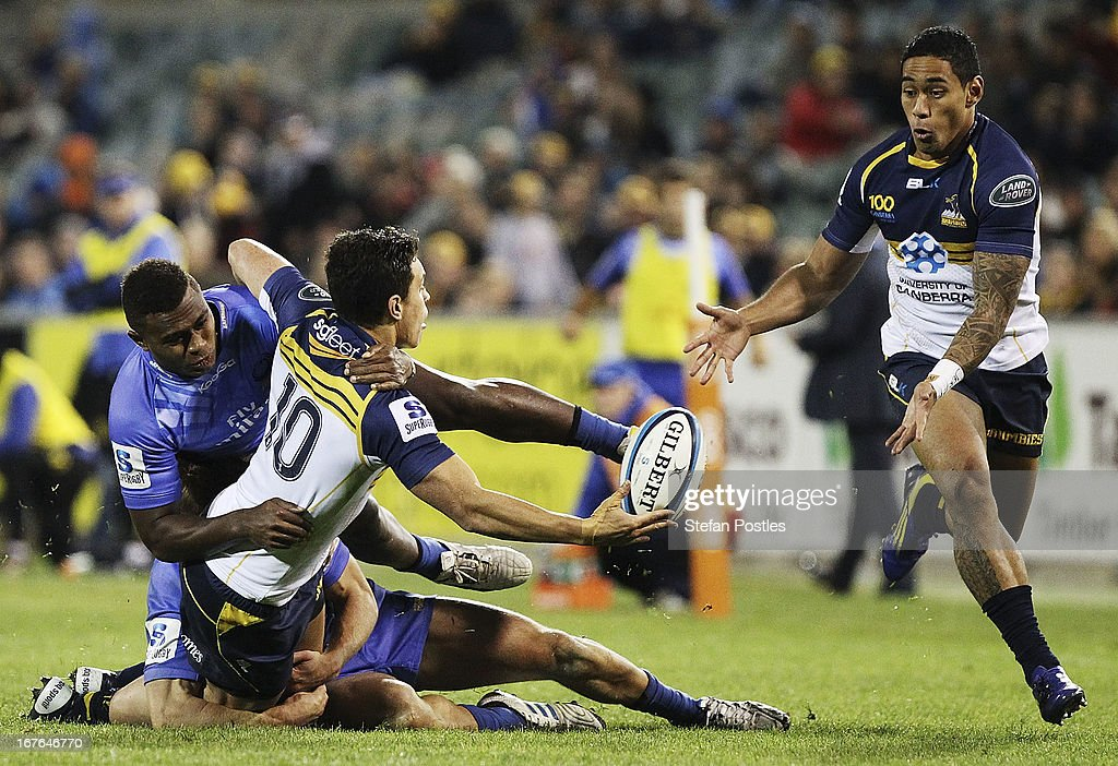 Matt Toomua of the Brumbies off loads the ball during the round 11 Super Rugby match between the Brumbies and the Force at Canberra Stadium on April 27, 2013 in Canberra, Australia.