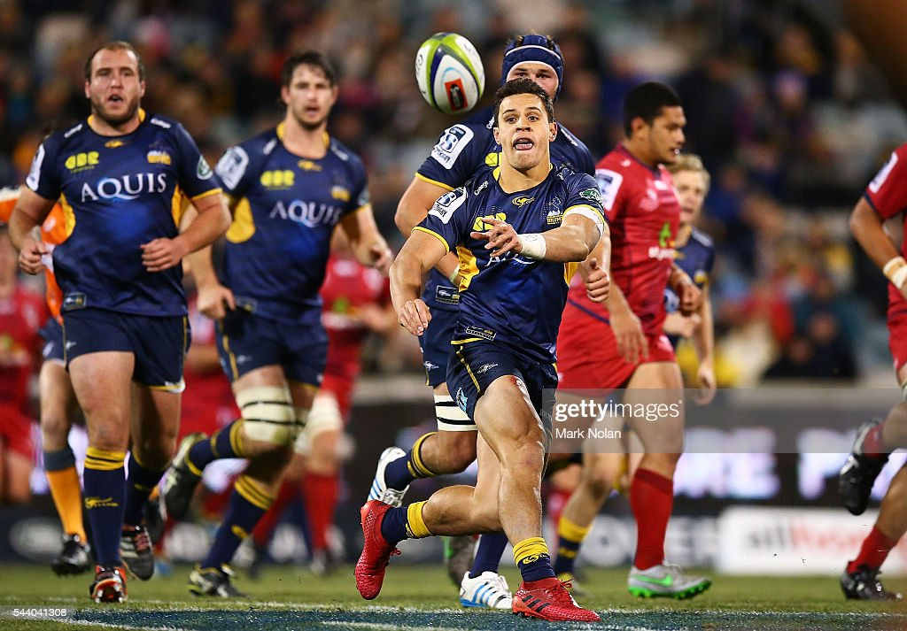 <a gi-track='captionPersonalityLinkClicked' href=/galleries/search?phrase=Matt+Toomua&family=editorial&specificpeople=4695215 ng-click='$event.stopPropagation()'>Matt Toomua</a> of the Brumbies passes during the round 15 Super Rugby match between the Brumbies and the Reds at GIO Stadium on July 1, 2016 in Canberra, Australia.
