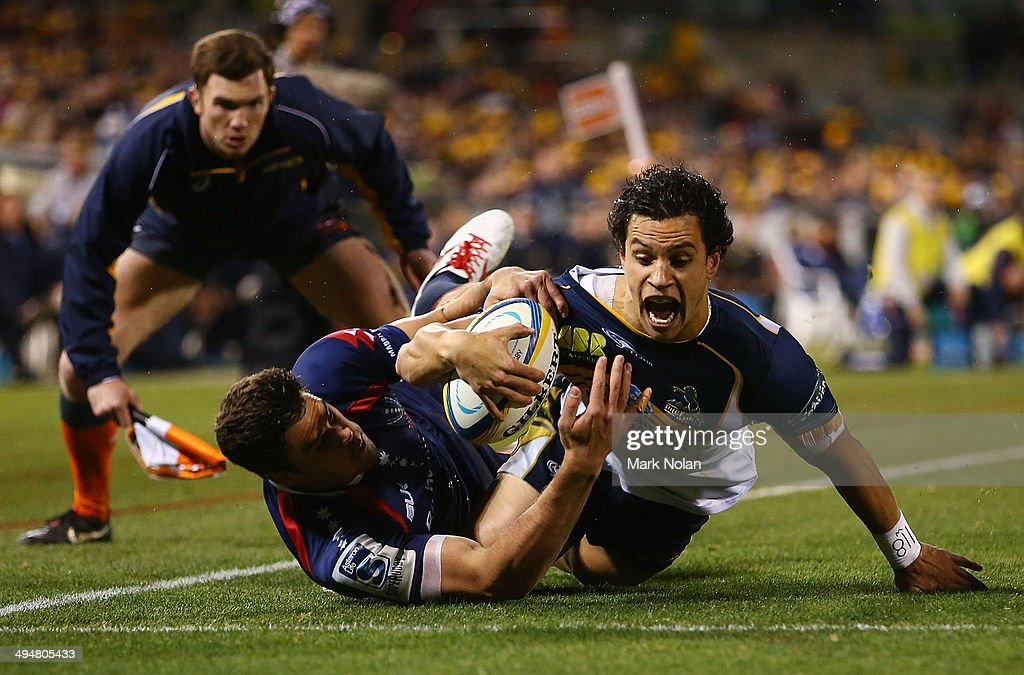 Matt Toomua of the Brumbies scores a try during the round 16 Super Rugby match between the Brumbies and the Rebels at Canberra Stadium on May 31 2014...
