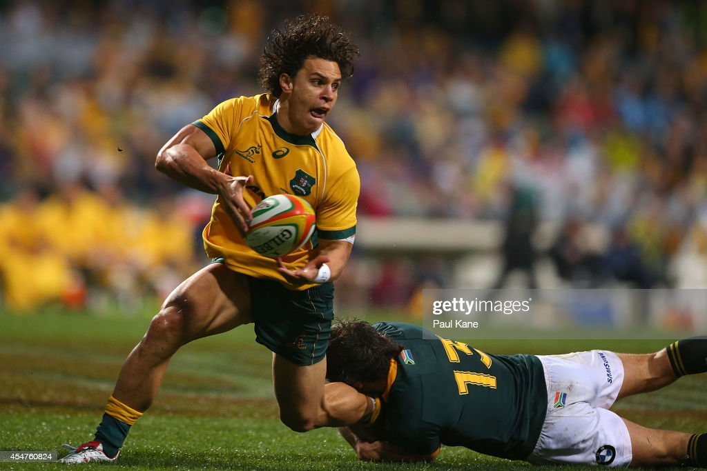 <a gi-track='captionPersonalityLinkClicked' href=/galleries/search?phrase=Matt+Toomua&family=editorial&specificpeople=4695215 ng-click='$event.stopPropagation()'>Matt Toomua</a> of the Wallabies looks to pass the ball while being tackled by <a gi-track='captionPersonalityLinkClicked' href=/galleries/search?phrase=Jan+Serfontein&family=editorial&specificpeople=9454171 ng-click='$event.stopPropagation()'>Jan Serfontein</a> of the Springboks during The Rugby Championship match between the Australian Wallabies and the South African Springboks at Patersons Stadium on September 6, 2014 in Perth, Australia.