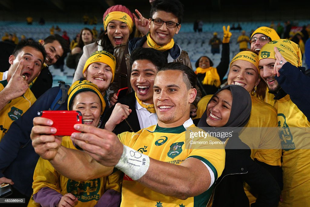 Matt Toomua of the Wallabies poses with fans after winning the Rugby Championship match between the Australia Wallabies and the New Zealand All Blacks at ANZ Stadium on August 8, 2015 in Sydney, Australia.