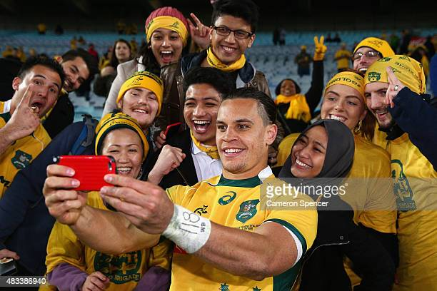 Matt Toomua of the Wallabies poses with fans after winning the Rugby Championship match between the Australia Wallabies and the New Zealand All...