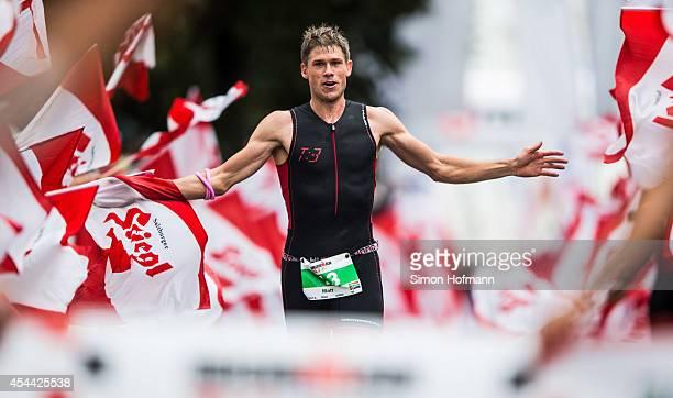 Matt Trautman celebrates as he finishes the Ironman 703 Zell am SeeKaprun on August 31 2014 in Zell am See Austria