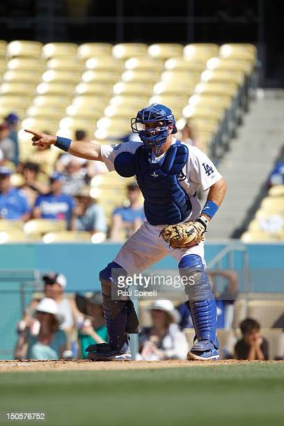Matt Treanor of the Los Angeles Dodgers directs the play to first base during the game against the San Diego Padres on Sunday July 15 2012 at Dodger...