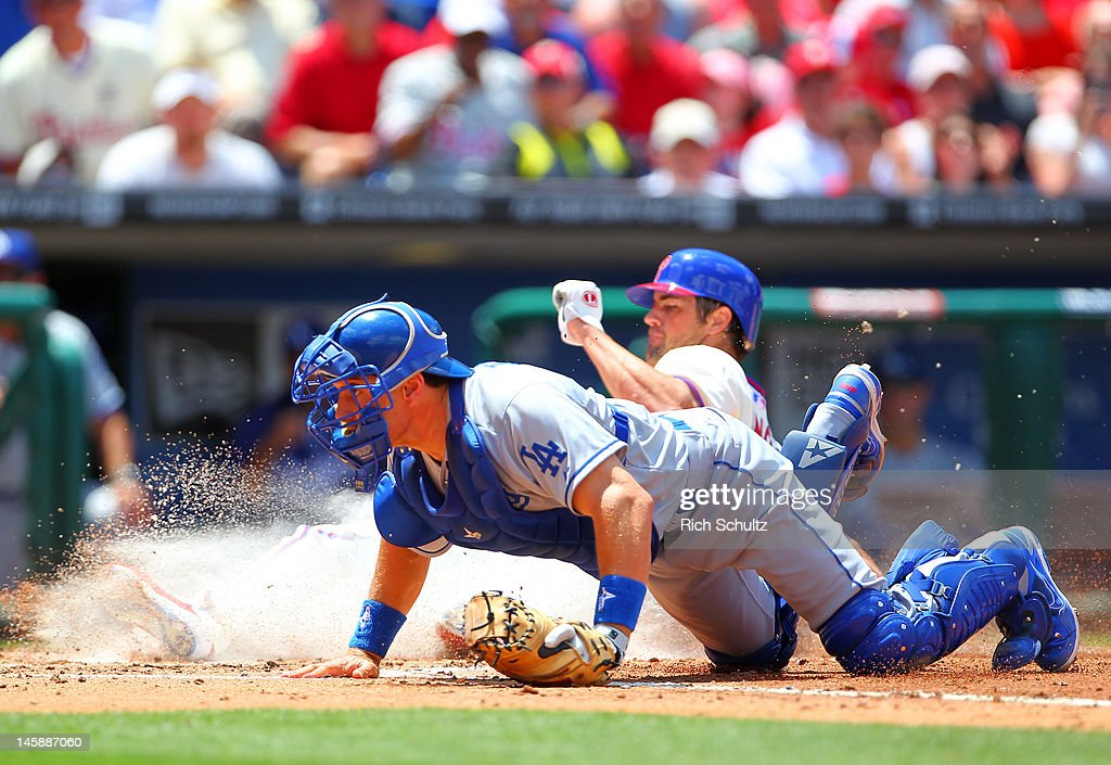 <a gi-track='captionPersonalityLinkClicked' href=/galleries/search?phrase=Matt+Treanor&family=editorial&specificpeople=242871 ng-click='$event.stopPropagation()'>Matt Treanor</a> #18 of the Los Angeles Dodgers looks behind home for the ball as <a gi-track='captionPersonalityLinkClicked' href=/galleries/search?phrase=Cole+Hamels&family=editorial&specificpeople=565675 ng-click='$event.stopPropagation()'>Cole Hamels</a> #35 of the Philadelphia Phillies scores on a fielders choice hit by Hunter Pence #3 in the third inning in a MLB baseball game on June 7, 2012 at Citizens Bank Park in Philadelphia, Pennsylvania.