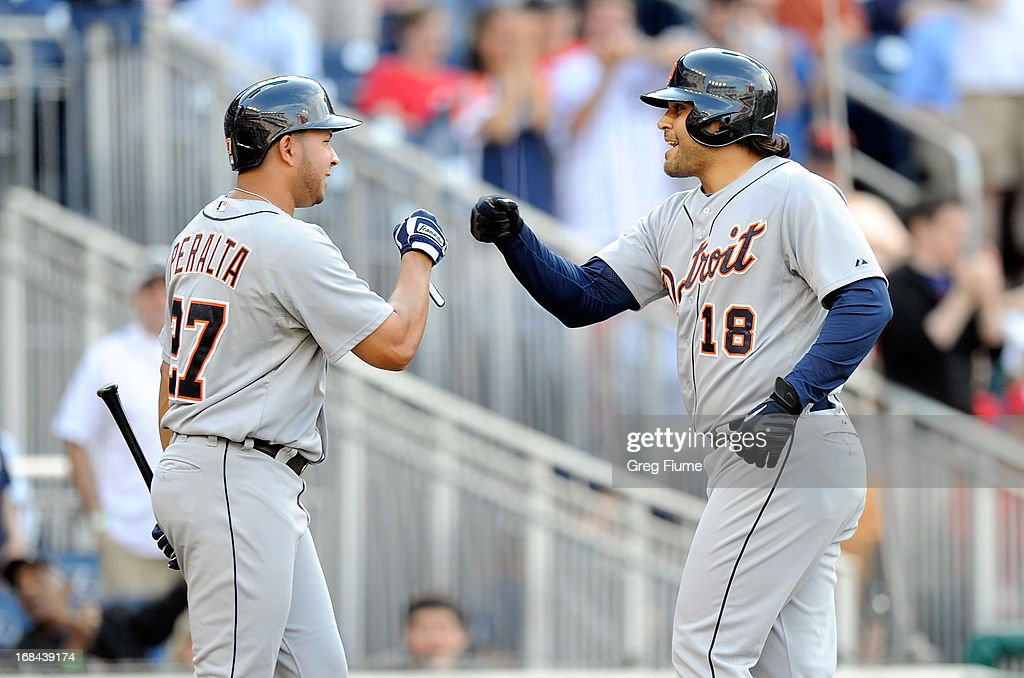 Matt Tuiasosopo #18 of the Detroit Tigers celebrates with <a gi-track='captionPersonalityLinkClicked' href=/galleries/search?phrase=Jhonny+Peralta&family=editorial&specificpeople=213286 ng-click='$event.stopPropagation()'>Jhonny Peralta</a> #27 after hitting a home run in the sixth inning against the Washington Nationals at Nationals Park on May 9, 2013 in Washington, DC.