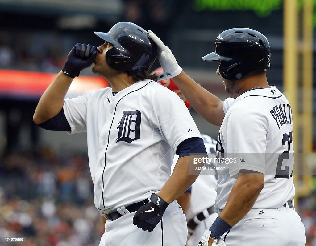 Matt Tuiasosopo #18 of the Detroit Tigers gets a pat on the helmet by <a gi-track='captionPersonalityLinkClicked' href=/galleries/search?phrase=Jhonny+Peralta&family=editorial&specificpeople=213286 ng-click='$event.stopPropagation()'>Jhonny Peralta</a> #27 after hitting a three-run home run against the Philadelphia Philles in the first inning at Comerica Park on July 27, 2013 in Detroit, Michigan.