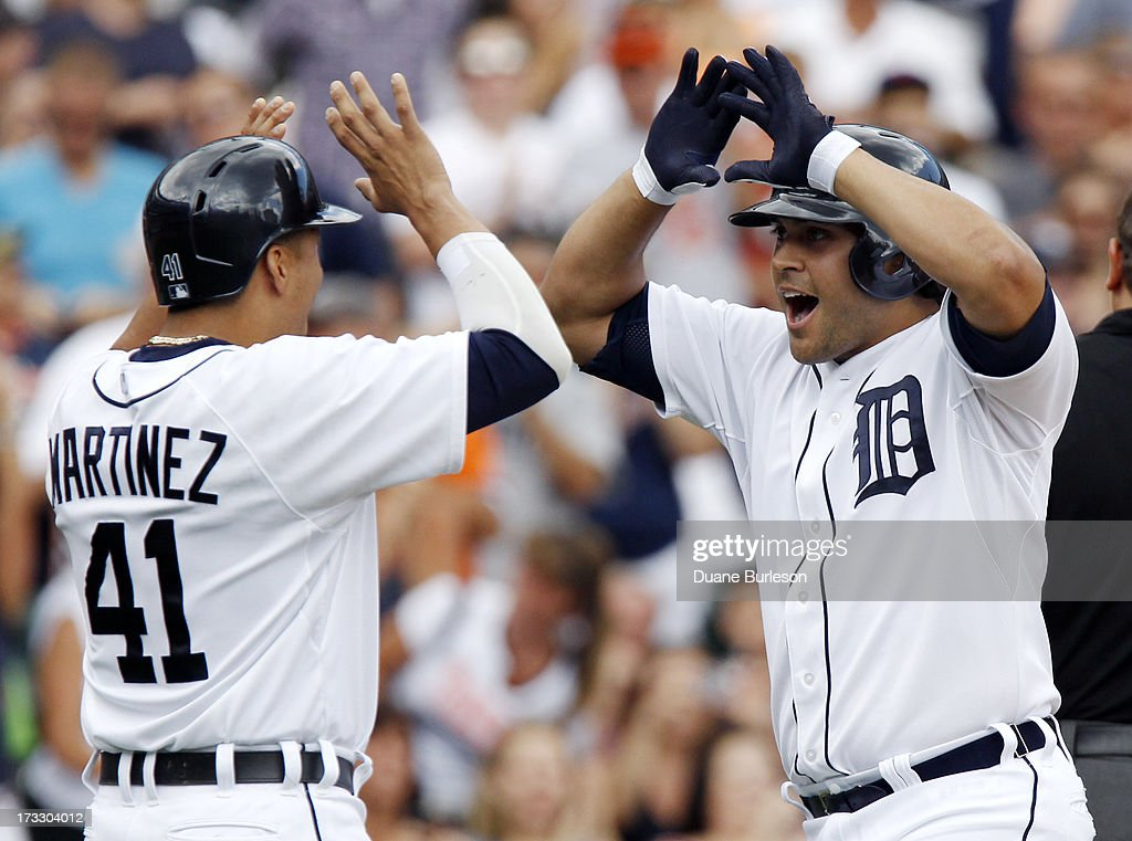Matt Tuiasosopo #18 of the Detroit Tigers is congratulated by Victor Martinez #41after hitting a two-run home run against the Chicago White Sox in the second inning at Comerica Park on July 11, 2013 in Detroit, Michigan.
