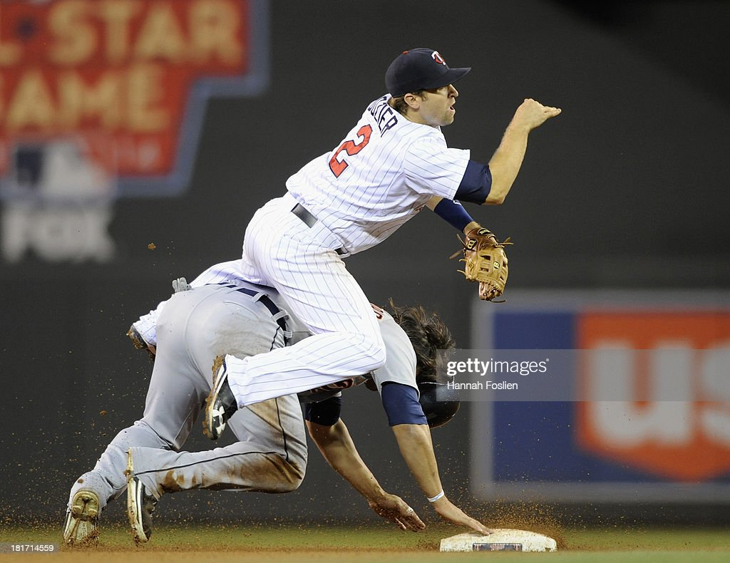 Matt Tuiasosopo #18 of the Detroit Tigers is out at second base as <a gi-track='captionPersonalityLinkClicked' href=/galleries/search?phrase=Brian+Dozier&family=editorial&specificpeople=7553002 ng-click='$event.stopPropagation()'>Brian Dozier</a> #2 of the Minnesota Twins is unable to turn a double play during the tenth inning of the game on September 23, 2013 at Target Field in Minneapolis, Minnesota. The Twins defeated the Tigers 4-3 in eleven innings.