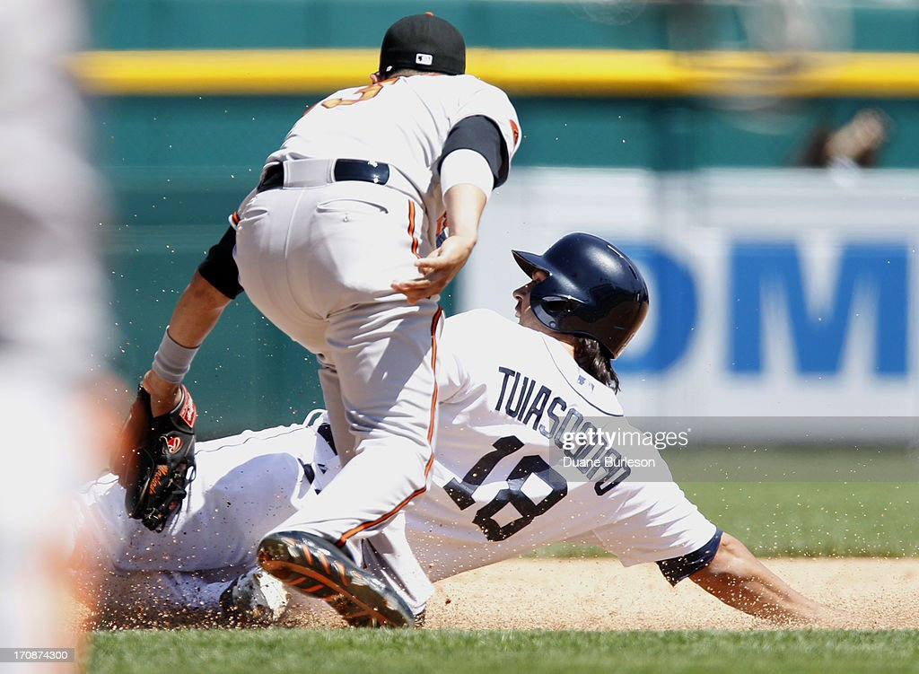 Matt Tuiasosopo #18 of the Detroit Tigers is tagged out at third base by <a gi-track='captionPersonalityLinkClicked' href=/galleries/search?phrase=Manny+Machado&family=editorial&specificpeople=5591039 ng-click='$event.stopPropagation()'>Manny Machado</a> #13 of the Baltimore Orioles while trying to advance on a single by Omar Infante in the sixth inning at Comerica Park on June 19, 2013 in Detroit, Michigan.