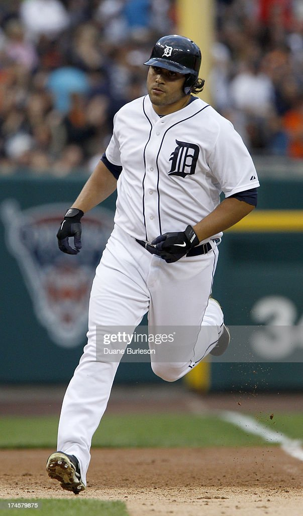 Matt Tuiasosopo #18 of the Detroit Tigers rounds the bases after hitting a three-run home run against the Philadelphia Philles in the first inning at Comerica Park on July 27, 2013 in Detroit, Michigan.