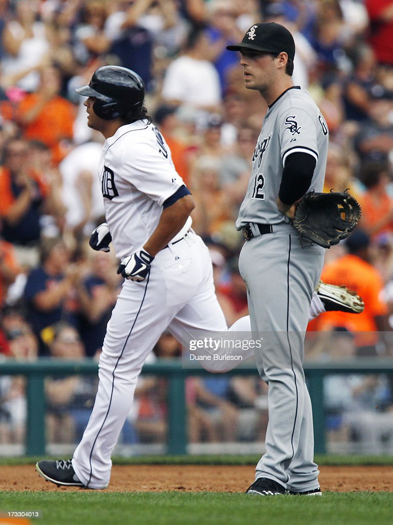 Matt Tuiasosopo #18 of the Detroit Tigers rounds the bases past third baseman <a gi-track='captionPersonalityLinkClicked' href=/galleries/search?phrase=Conor+Gillaspie&family=editorial&specificpeople=5115369 ng-click='$event.stopPropagation()'>Conor Gillaspie</a> #12 of the Chicago White Sox after hitting a two-run home run in the second inning at Comerica Park on July 11, 2013 in Detroit, Michigan.