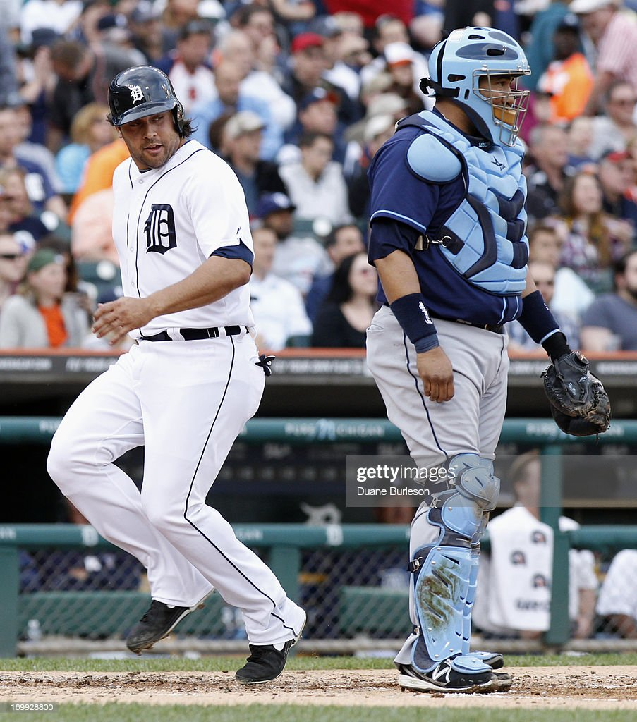 Matt Tuiasosopo #18 of the Detroit Tigers scores past Jose Molina #28 of the Tampa Bay Rays on a bases-loaded walk in the third inning at Comerica Park on June 4, 2013 in Detroit, Michigan. The Tigers defeated the Rays 10-1.