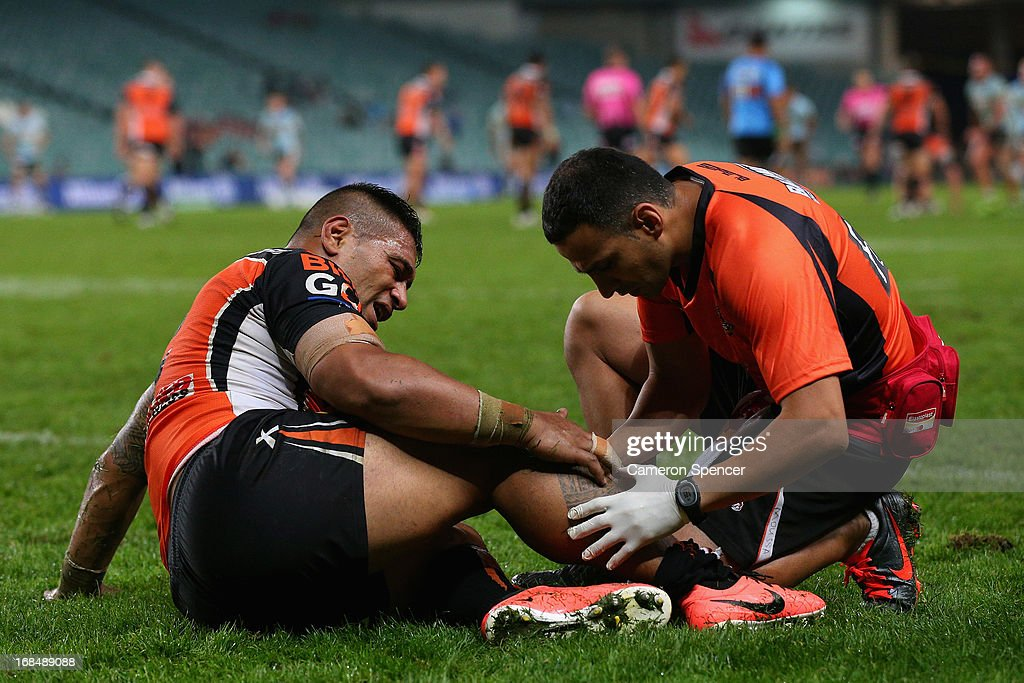 Matt Utai of the Tigers receives attention during the round nine NRL match between the Wests Tigers and the Cronulla Sharks at Allianz Stadium on May 10, 2013 in Sydney, Australia.