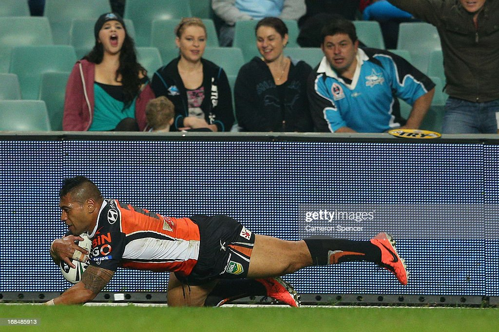 <a gi-track='captionPersonalityLinkClicked' href=/galleries/search?phrase=Matt+Utai&family=editorial&specificpeople=214110 ng-click='$event.stopPropagation()'>Matt Utai</a> of the Tigers scores a try during the round nine NRL match between the Wests Tigers and the Cronulla Sharks at Allianz Stadium on May 10, 2013 in Sydney, Australia.
