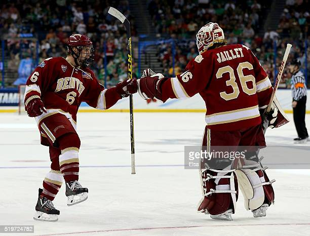 Matt VanVoorhis of the Denver Pioneers celebrates his goal with teammate Tanner Jaillet in the third period against the North Dakota Fighting Hawks...