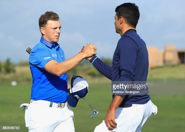 Matt Wallace of England and Julian Suri of the United States shake hands after their round during day three of the Open de Portugal at Morgado Golf...