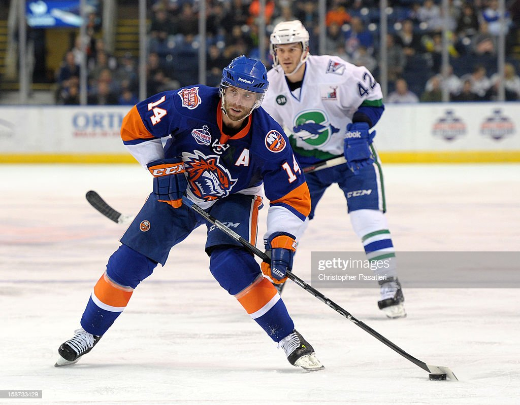 Matt Watkins #14 of the Bridgeport Sound Tigers takes a shot on goal during an American Hockey League game against the Connecticut Whale on December 26, 2012 at the Webster Bank Arena at Harbor Yard in Bridgeport, Connecticut.