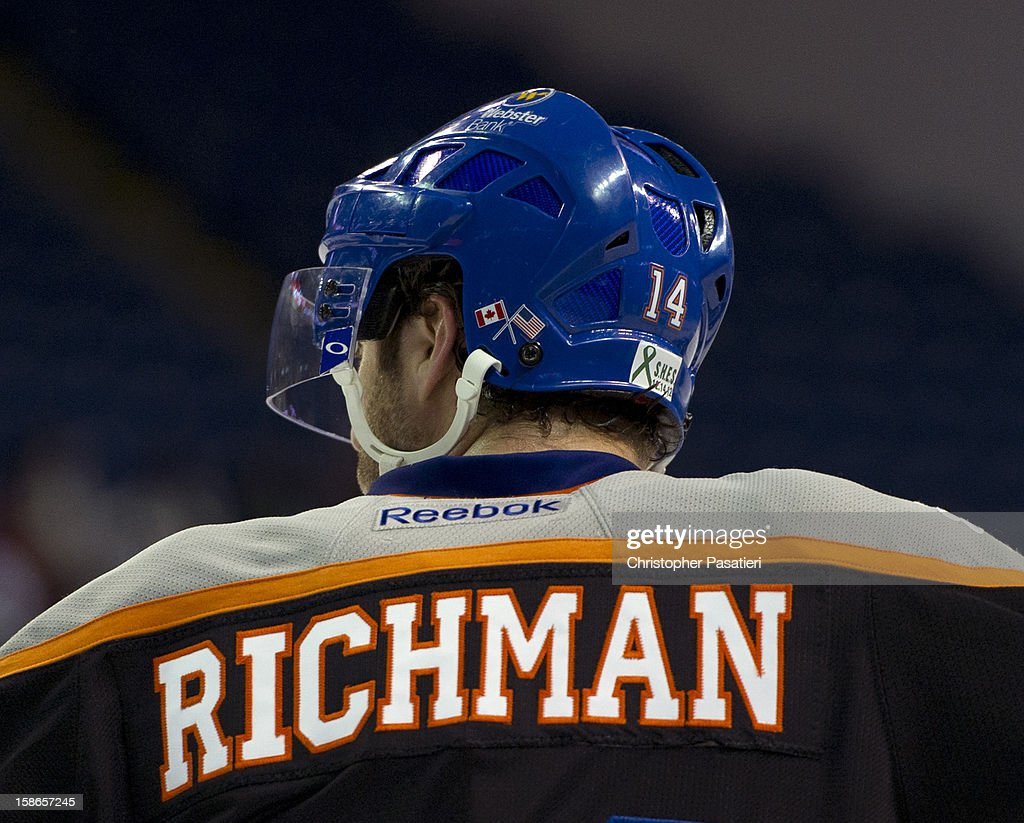 Matt Watkins #14 of the Bridgeport Sound Tigers wears the name of Sandy Hook Elementary School shooting victim Avielle Richman on the back of his jersey as part of a tribute during an American Hockey League game against the Adirondack Phantoms on December 22, 2012 at the Webster Bank Arena at Harbor Yard in Bridgeport, Connecticut.