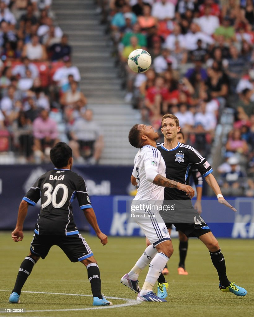 Matt Watson of the Vancouver Whitecaps heads the ball in front of Clarence Goodson of the San Jose Earthquakes during an MLS match at BC Place on...