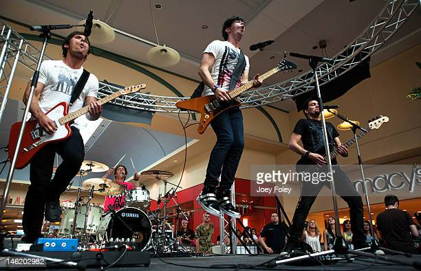 Matt Webb Ian Casselman Josh Ramsay and Mike Ayley of the rock band Marianas Trench perform live onstage at Journeys Backyard BBQ Tour at Castleton...