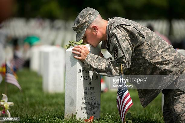 Matt Weber kisses the grave of his buddy Joseph John Anzack Jr in Section 60 the burial ground for military personnel killed since 2001 at Arlington...