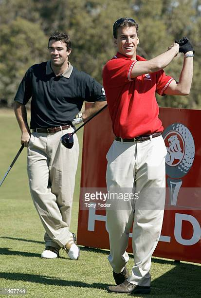 Matt Welsh Australian swimmer and Chris Scott AFL player with the Brisbane Lions hit off on the first tee during the launch of the Holden Australian...