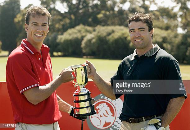Matt Welsh Australian swimmer and Chris Scott AFL player with the Brisbane Lions hold the Australian Open Golf trophy during the launch of the Holden...