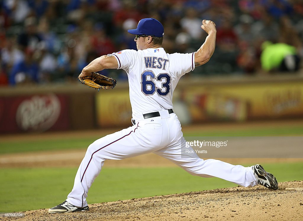 Matt West #63 of the Texas Rangers throws in the sixth inning against the Los Angeles Angels of Anaheim at Globe Life Park in Arlington on July 10, 2014 in Arlington, Texas.