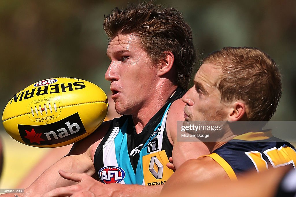 Matt White of the Power gets tackled by Sam Kerridge of the Crows during the round two AFL NAB Challenge Cup match between the Adelaide Crows and the...