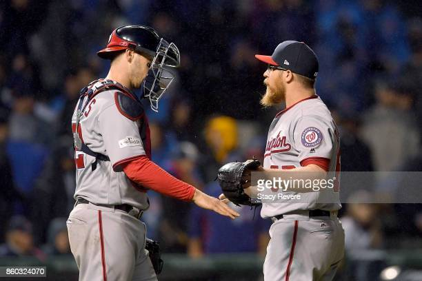 Matt Wieters and Sean Doolittle of the Washington Nationals celebrate after defeating the Chicago Cubs 50 in game four of the National League...