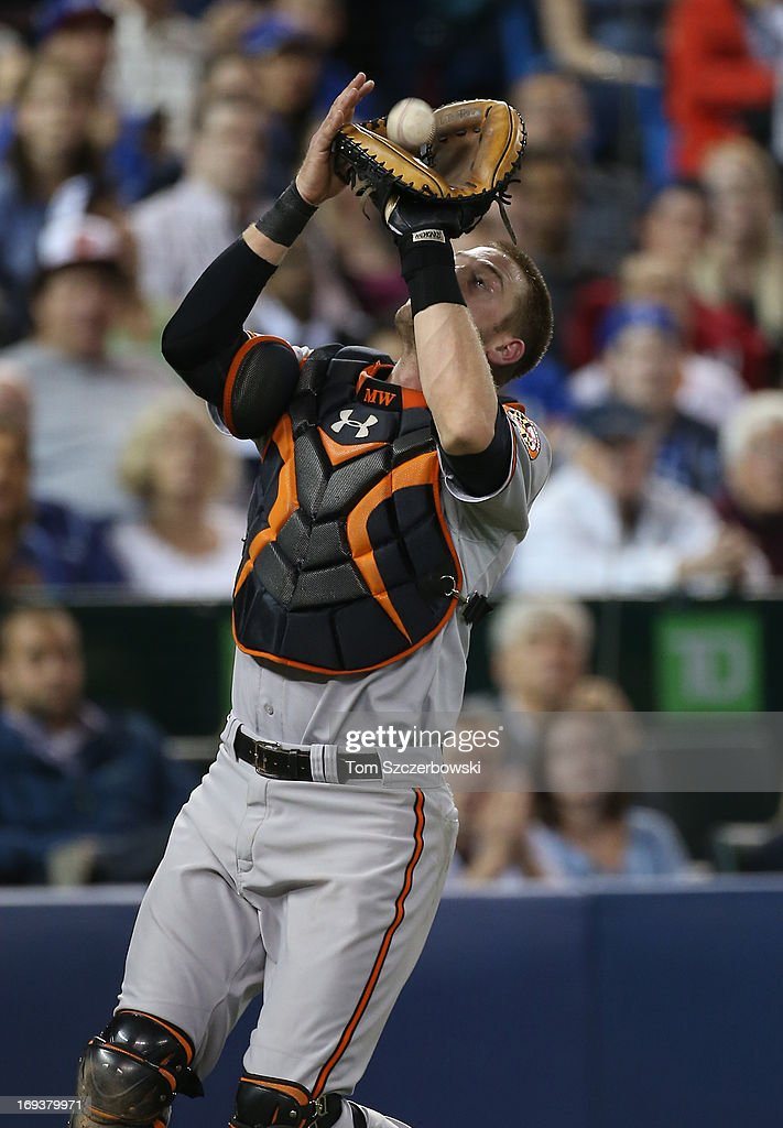 <a gi-track='captionPersonalityLinkClicked' href=/galleries/search?phrase=Matt+Wieters&family=editorial&specificpeople=4498276 ng-click='$event.stopPropagation()'>Matt Wieters</a> #32 of the Baltimore Orioles catches a foul pop up in the fourth inning during MLB game action against the Toronto Blue Jays on May 23, 2013 at Rogers Centre in Toronto, Ontario, Canada.