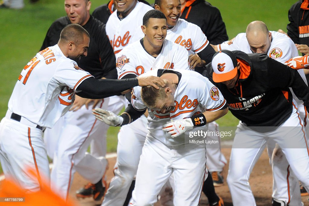 <a gi-track='captionPersonalityLinkClicked' href=/galleries/search?phrase=Matt+Wieters&family=editorial&specificpeople=4498276 ng-click='$event.stopPropagation()'>Matt Wieters</a> #32 of the Baltimore Orioles celebrates a walk off home run in the tenth inning during a baseball game against the Pittsburgh Pirates in game two of a doubleheader on May 1, 2014 at Oriole Park at Camden Yards in Baltimore, Maryland. The Orioles won 6-5 in the tenth inning.