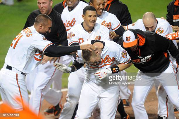 Matt Wieters of the Baltimore Orioles celebrates a walk off home run in the tenth inning during a baseball game against the Pittsburgh Pirates in...