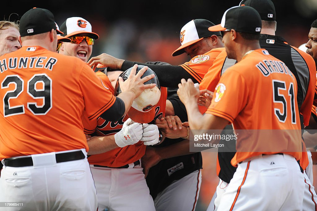 <a gi-track='captionPersonalityLinkClicked' href=/galleries/search?phrase=Matt+Wieters&family=editorial&specificpeople=4498276 ng-click='$event.stopPropagation()'>Matt Wieters</a> #32 of the Baltimore Orioles celebrates a walk off single with team mates in the tenth inning during a baseball game against the Chicago White Sox on September 7, 2013 at Oriole Park at Camden Yards in Baltimore, Maryland. The Orioles won 4-3 in the tenth inning.