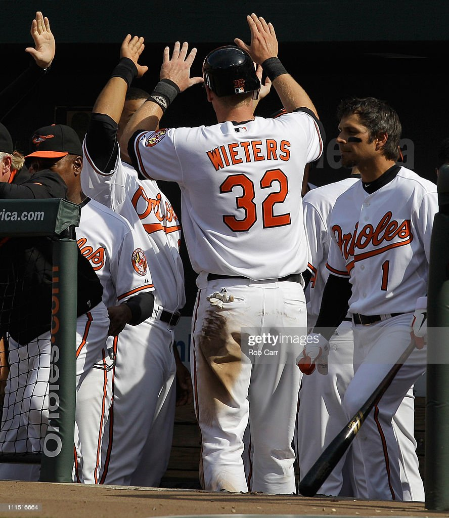 Matt Wieters #32 of the Baltimore Orioles celebrates after scoring on a wild pitch by the Detroit Tigers during the secon inning during opening day at Oriole Park at Camden Yards on April 4, 2011 in Baltimore, Maryland.