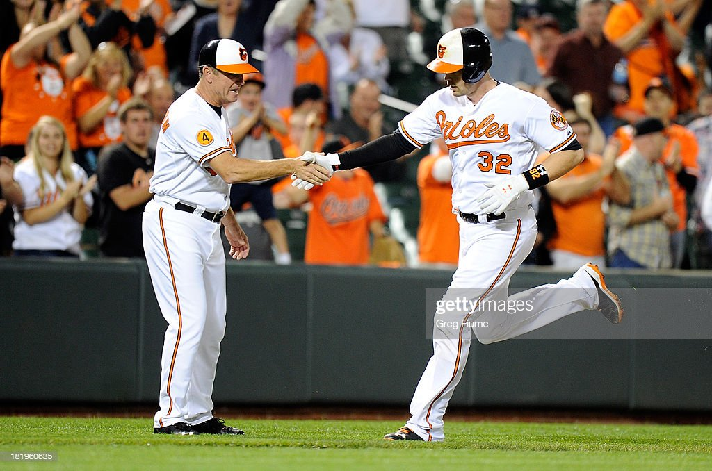 <a gi-track='captionPersonalityLinkClicked' href=/galleries/search?phrase=Matt+Wieters&family=editorial&specificpeople=4498276 ng-click='$event.stopPropagation()'>Matt Wieters</a> #32 of the Baltimore Orioles celebrates with third base coach Bobby Dickerson #11 after hitting a home run in the second inning against the Toronto Blue Jays at Oriole Park at Camden Yards on September 26, 2013 in Baltimore, Maryland.
