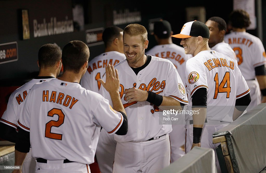 <a gi-track='captionPersonalityLinkClicked' href=/galleries/search?phrase=Matt+Wieters&family=editorial&specificpeople=4498276 ng-click='$event.stopPropagation()'>Matt Wieters</a> #32 of the Baltimore Orioles (R) celebrates withi J.J. Hardy #2 after hitting a walk off grand slam to give the Orioles a 10-6 win in ten innings at Oriole Park at Camden Yards on April 18, 2013 in Baltimore, Maryland.
