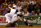 Matt Wieters of the Baltimore Orioles fields a late throw as Jacoby Ellsbury of the Boston Red Sox scores the tying run in the 7th inning at Fenway...