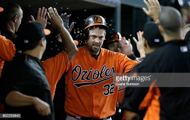 Matt Wieters of the Baltimore Orioles has seeds tossed at him while celebrating a threerun home run against the Detroit Tigers during the sixth...