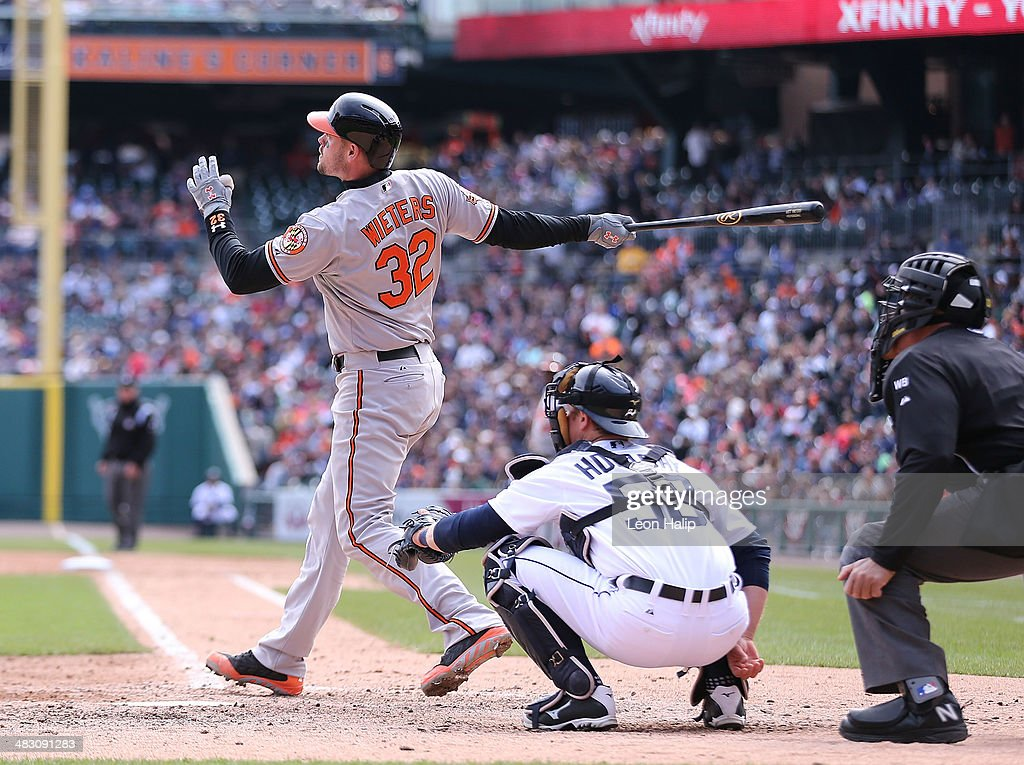Matt Wieters #32 of the Baltimore Orioles hits a ninth inning solo home run to left field during the game against the Detroit Tigers at Comerica Park on April 6, 2014 in Detroit, Michigan. The Orioles defeated the Tigers 3-1.