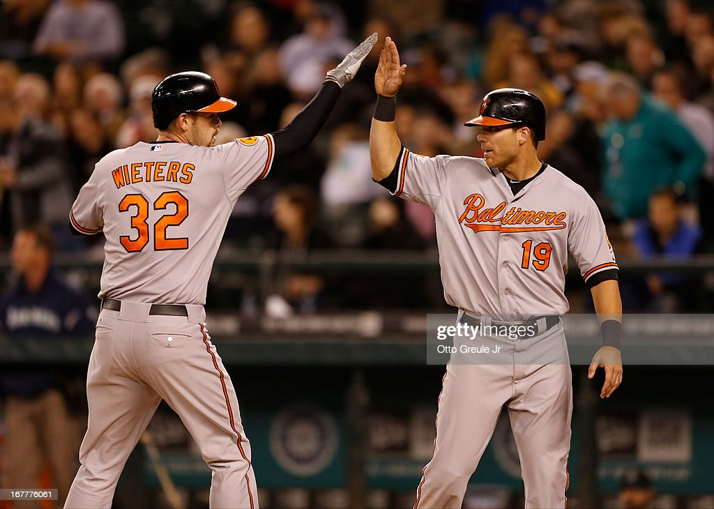 <a gi-track='captionPersonalityLinkClicked' href=/galleries/search?phrase=Matt+Wieters&family=editorial&specificpeople=4498276 ng-click='$event.stopPropagation()'>Matt Wieters</a> #32 of the Baltimore Orioles is congratulated by Chris Davis #19 after hitting a home run in the fourth inning against the Seattle Mariners at Safeco Field on April 29, 2013 in Seattle, Washington.