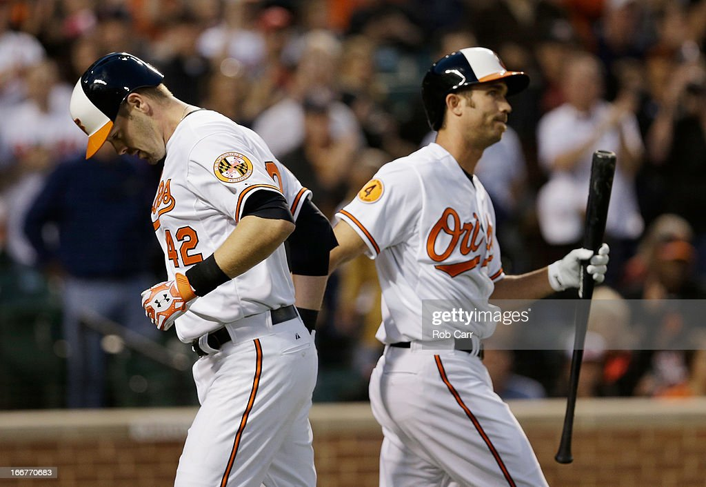 <a gi-track='captionPersonalityLinkClicked' href=/galleries/search?phrase=Matt+Wieters&family=editorial&specificpeople=4498276 ng-click='$event.stopPropagation()'>Matt Wieters</a> #32 of the Baltimore Orioles is congratulated by <a gi-track='captionPersonalityLinkClicked' href=/galleries/search?phrase=J.J.+Hardy&family=editorial&specificpeople=216446 ng-click='$event.stopPropagation()'>J.J. Hardy</a> #2 after hitting a solo homerun against the Tampa Bay Rays during the second inning at Oriole Park at Camden Yards on April 16, 2013 in Baltimore, Maryland. All uniformed members of both teams are wearing jersey number 42 in honor of Jackie Robinson Day.