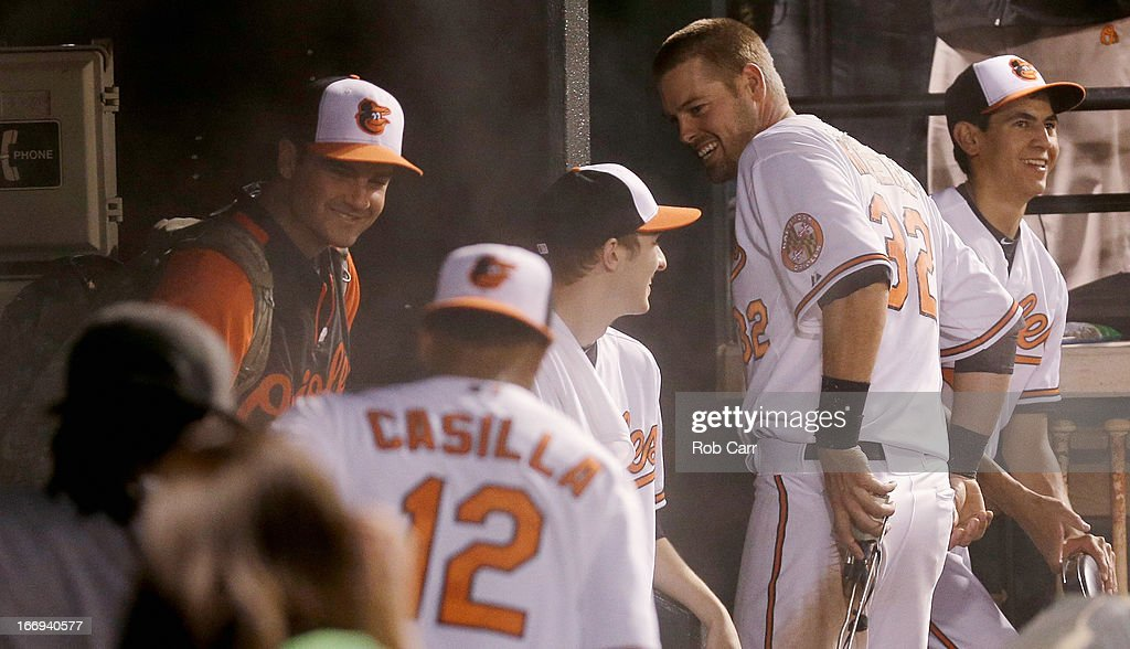 <a gi-track='captionPersonalityLinkClicked' href=/galleries/search?phrase=Matt+Wieters&family=editorial&specificpeople=4498276 ng-click='$event.stopPropagation()'>Matt Wieters</a> #32 of the Baltimore Orioles reacts in the dugout after doused him with powder following his walk off grand slam to give the Orioles a 10-6 win over the Tampa Bay Rays at Oriole Park at Camden Yards on April 18, 2013 in Baltimore, Maryland.