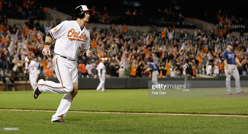 Matt Wieters #32 of the Baltimore Orioles rounds the bases after hitting a walk off grand slam to give the Orioles a 10-6 win in ten innings at Oriole Park at Camden Yards on April 18, 2013 in Baltimore, Maryland.