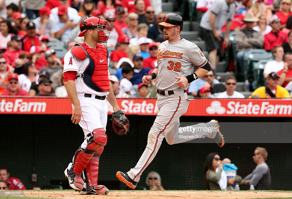 <a gi-track='captionPersonalityLinkClicked' href=/galleries/search?phrase=Matt+Wieters&family=editorial&specificpeople=4498276 ng-click='$event.stopPropagation()'>Matt Wieters</a> #32 of the Baltimore Orioles scores a run past catcher <a gi-track='captionPersonalityLinkClicked' href=/galleries/search?phrase=Chris+Iannetta&family=editorial&specificpeople=836137 ng-click='$event.stopPropagation()'>Chris Iannetta</a> #17 of the Los Angeles Angels of Anaheim in the eighth inning at Angel Stadium of Anaheim on May 5, 2013 in Anaheim, California. The Orioles won 8-4.
