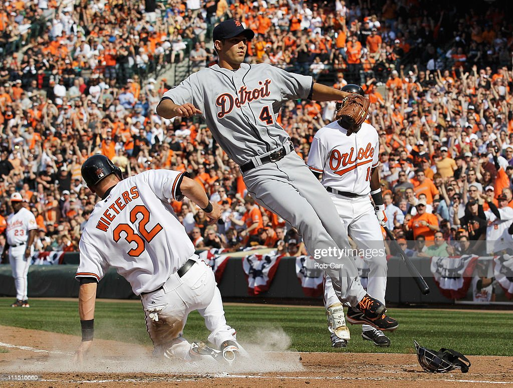 Matt Wieters #32 of the Baltimore Orioles slides safely into home plate to score on a wild pitch by starting pitcher Rick Porcello #48 of the Detroit Tigers in the second inning at Oriole Park at Camden Yards on April 4, 2011 in Baltimore, Maryland.