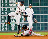 Matt Wieters of the Baltimore Orioles slides under the tag of Jose Altuve of the Houston Astros in the ninth inning at Minute Maid Park on May 24...